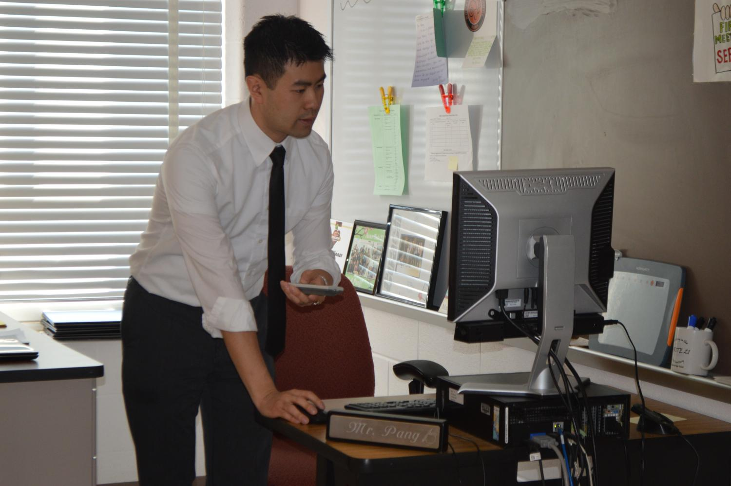 Washington Post 2017 Teacher of the Year Sean Pang gets ready for instruction time at his desk. He was out of 21 other finalists and has been a teacher at RHS for six years.