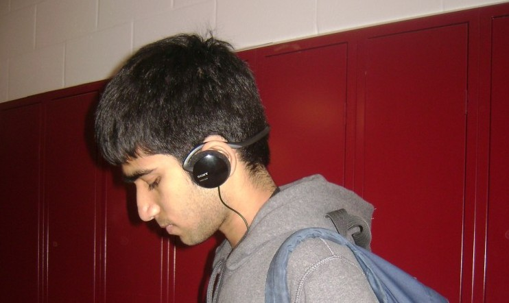 Many students listen to their iPods during lunch to simply relieve the stress of the school day. -- Melissa Holler