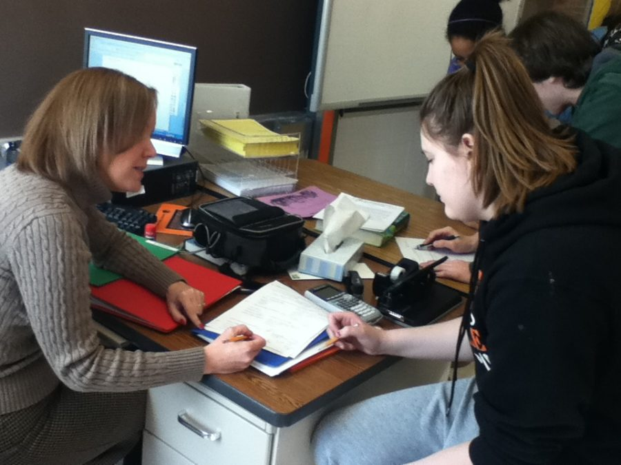 Math teacher Staci Lang helps a student on her pre-calculus work -- Luke Cooper-Martin
