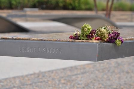 A flower sits atop a bench at the Pentagon Memorial in Arlington, Va. The Memorial is a touching tribute to victims who lost their lives. -- Anne Wagner.