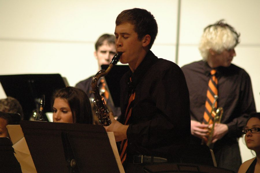 Senior+Kurtis+Swartz+passionately+plays+a+solo+for+the+jazz+band.