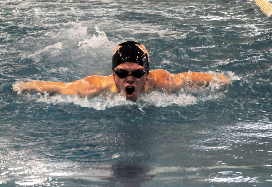 Senior+Edward+Kirk+swims+butterfly+in+a+race+against+Gaithersburg.+Kirk+has+been+a+member+of+the+swim+team+since+his+freshman+year.
