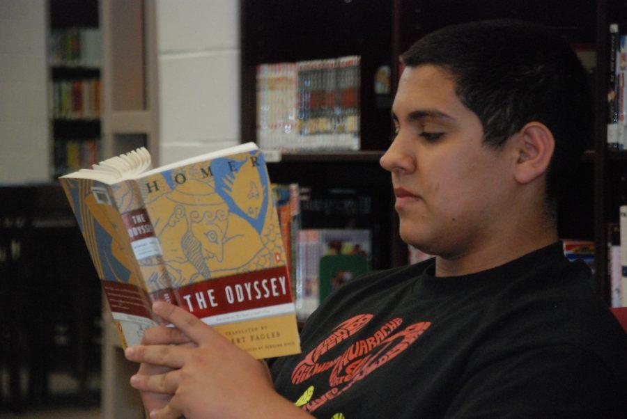 +Junior+Ivan+Ivanic+reads+a+summer+reading+book+in+the+IMC.+--+Adam+Bensimhon
