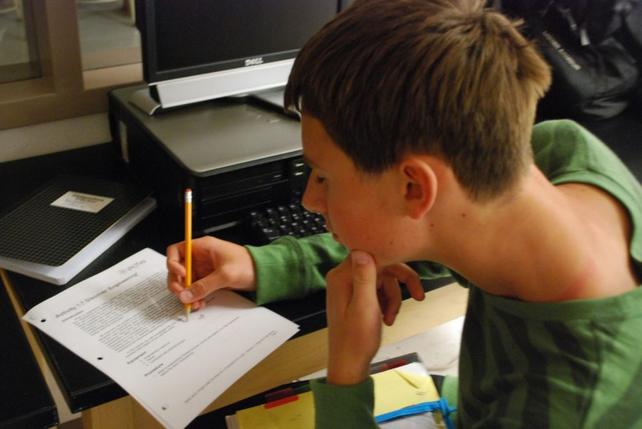 Sophomore+Kellen+Cremins+works+on+his+classwork+in+his+tech+class.+--Thomas+Sheil