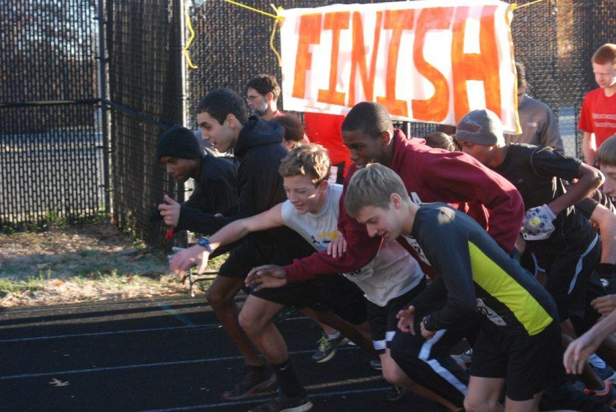 Students+at+the+starting+point+lunge+forward+to+begin+the+RamPace+5k+2012.+Winner+Billy+Kirk+pushes+through+the+other+runners+to+start+off+as+the+leader+in+the+race.+--Adam+Bensimhon