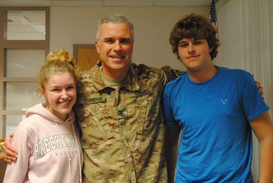 Madeline+and+Luke+Schaefer+happily+pose+with+their+father%2C+Colonel+Richard+Schaefer+after+he+was+stationed+in+Afghanistan+for+six+months+as+a+military+doctor.+Col.+Schaefer+returned+Oct.+30%2C+an+emotional+day+for+the+whole+family.+--Camila+Torres