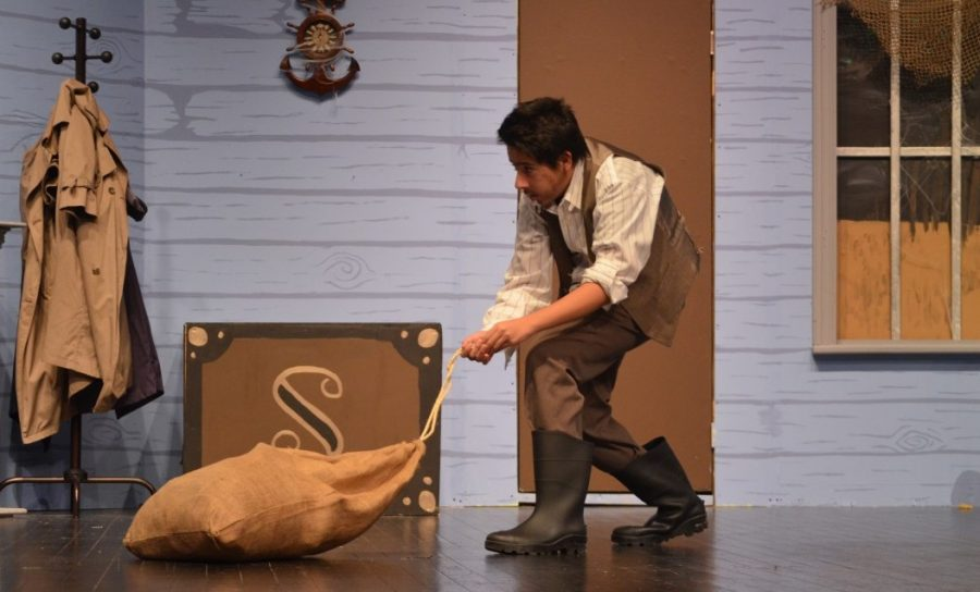 Ebenezer Saltmarsh, played by senior Luke Cooper-Martin and freshman Andrew Mijango (pictured above) drag a sack with the body of a nurse across the stage. Saltmarsh caused chaos and confusion for all the other unsuspecting characters at their stay at Ye Old Wayside Inn. --Adam Bensimhon