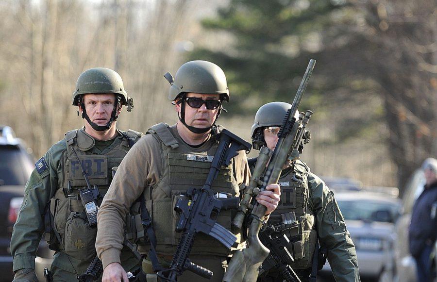 FBI+SWAT+team+members+walk+along+Dickinson+Drive+near+Sandy+Hook+Elementary+School+in+Newtown%2C+Connecticut%2C+Friday%2C+December+14%2C+2012.+Twenty-seven+people%2C+including+18+children%2C+have+been+killed+in+a+shooting+at+Sandy+Hook+Elementary+School.+Courtesy+of+MCT+Campus