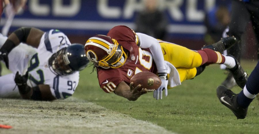 Washington+Redskins+quarterback+Robert+Griffin+III+dives+for+a+first+down+in+the+first+half+against+Seattle+Seahawks+during+the+first+round+of+the+NFC+wild-card+playoff+game+at+FedEx+Field+in+Landover%2C+Maryland%2C+Sunday%2C+January+6%2C+2013.+Courtesy+of+MCT+Campus