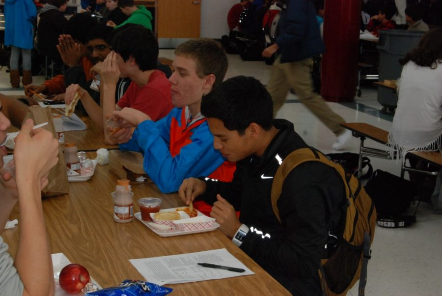 Seniors+eat+at+lunchtime+with+styrofoam+lunch+trays%2C+unaware+of+the+path+the+trays+will+take+when+they+are+thrown+away.+--David+Lopez
