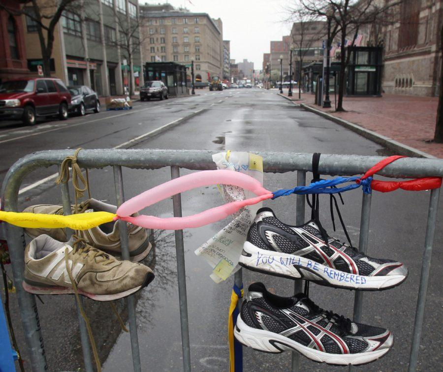 Sneakers hang on gate in memory of the Boston Marathon bombing in Boston, Massachusetts. Courtesy of MCT Campus