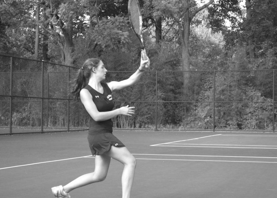 Senior+Vicky+Ganev+follows+through+after+hitting+a+ball+during+a+home+match+against+Quince+Orchard+Oct+17.+Ganev+along+with+the+rest+of+the+Lady+Rams+finish+their+season+at+5-7+and+begin+to+prepare+for+an+exciting+county+tournament.