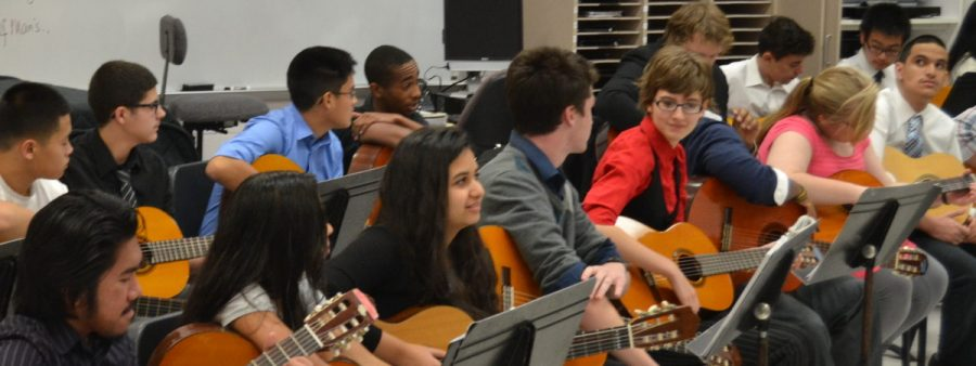 Guitar+students+prepare+their+instruments+for+the+concert.+The+students+played+together+along+with+some+individual+performers+such+as+freshman+Riordan+Caisse+playing+%22Hey+There+Delilah.%22+--Elissa+Britt