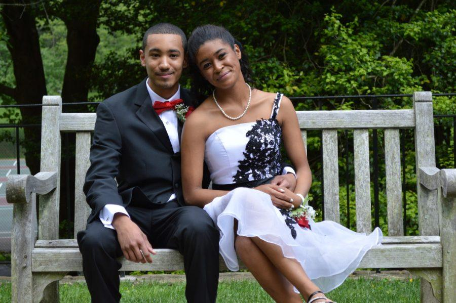 Bradley+Brea+and+Gabriela+Hernandez+sit+on+the+benches+of+the+Civic+Center+for+pre-prom+photos.