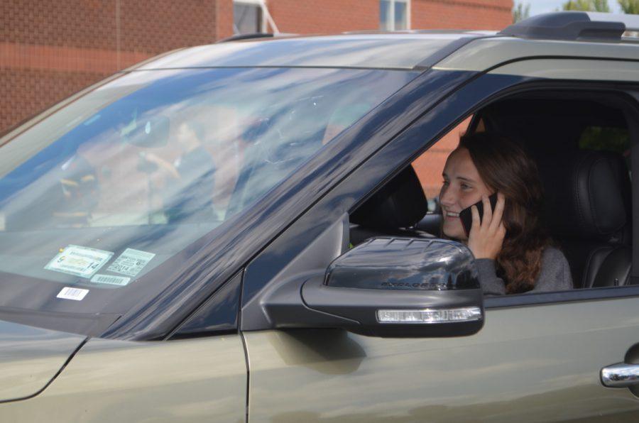 Senior+Kathleen+McTighe+mimics+a+phone+call+while+driving.+--Elissa+Britt