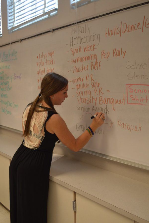 Senior+Lauren+Goldstein+helps+organize+future+school+functions+by+writing+the+events+that+need+to+be+planned.+--Mercy+Fosah