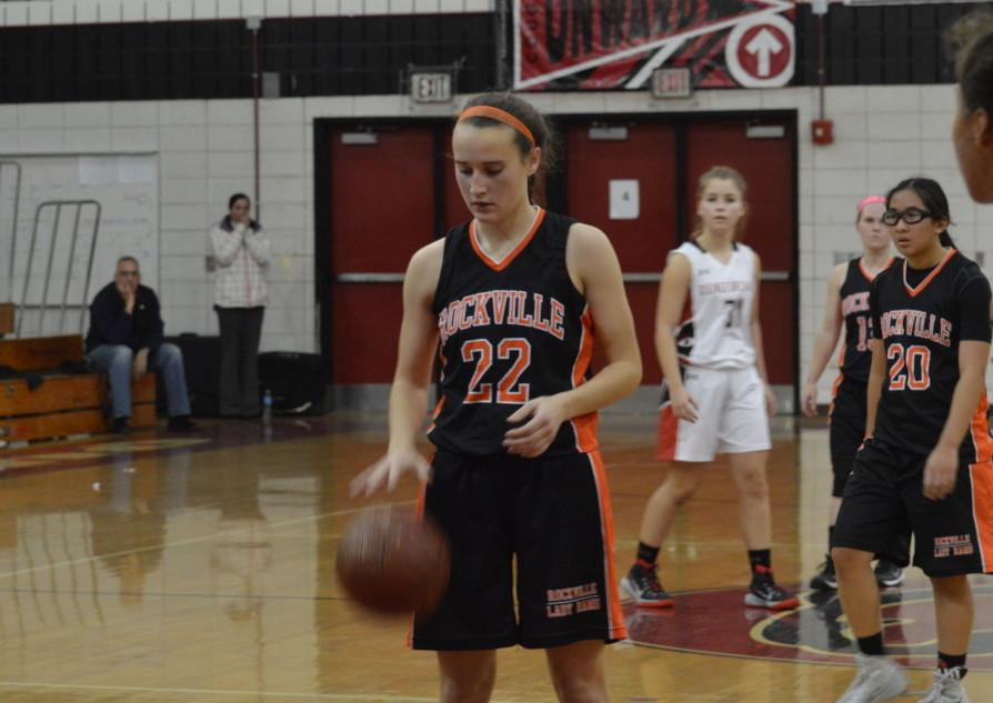 Senior+captain+Kathleen+McTighe+prepares+for+a+free+throw+against+Quince+Orchard+HS.+The+Lady+Rams+lost+45-39%2C+making+only+nine+of+20+free+throws.+Weaver+now+emphasizes+practicing+free+throws+because+it+will+help+win+games.+--Claudia+Mirembe