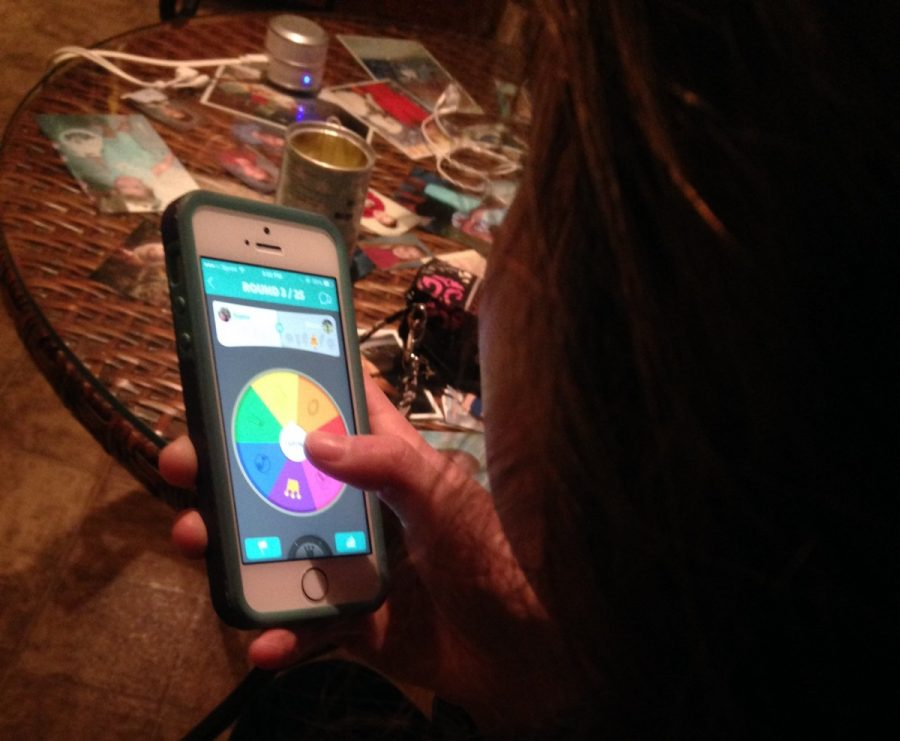 A+student+plays+Trivia+Crack+from+her+home.+The+game+has+caught+on+in+mass+popularity+amongst+Smart+Phone+users%2C+including+teachers.+--Tayor+DeAth