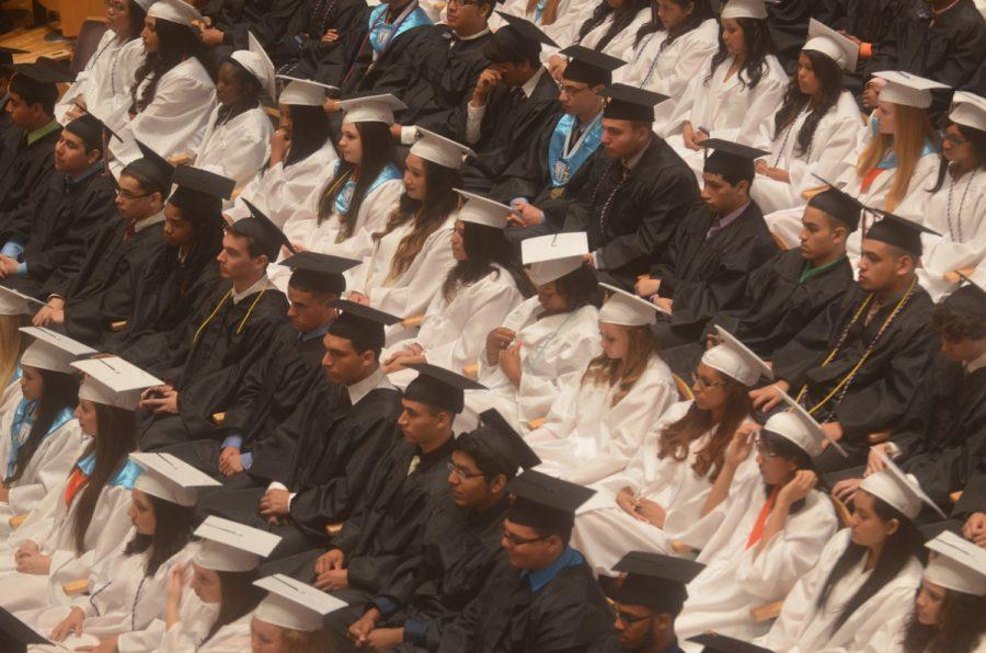 Graduates+from+the+class+of+2014+wore+black+and+white+gowns.+The+contreversy+for+the+gown+color+for+the+class+of+2015+will+follow+in+RHS+tradition+of+black+and+white.+--Camilla+Torres