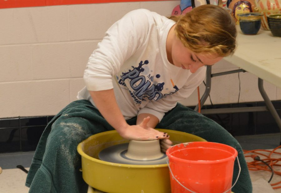 After+centering+her+clay%2C+junior+Erin+Moriarty+crafts+her+bowl+on+the+potter%E2%80%99s+wheel+during+Art+Blitz+Week.+The+event+ran+from+Jan.+26+to+Jan.+30+in+the+arts+hallway+to+help+recruit+students+for+art+classes.+--Elissa+Britt