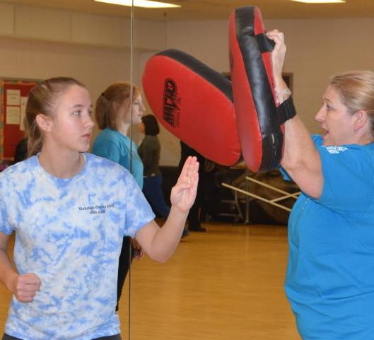 Sophomore Hannah Sarsony practices an attack with a professional trainer in a women's self defense class that was offered at RHS to women over 14 by Rape Agression Defense systems. --Meklit Bekele