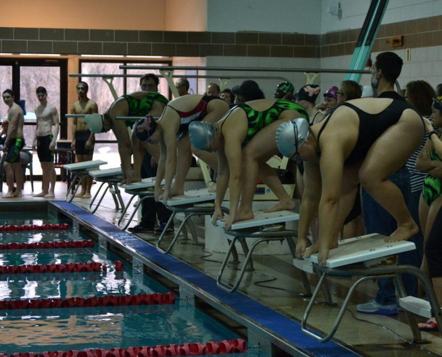 RHS+and+Kennedy+HS+swimmers+take+their+mark+as+they+prepare+to+race.+The+girls+swim+team+has+been+facing+challenges+with+participation+this+season%2C+but+still+push+through.+--Elissa+Britt