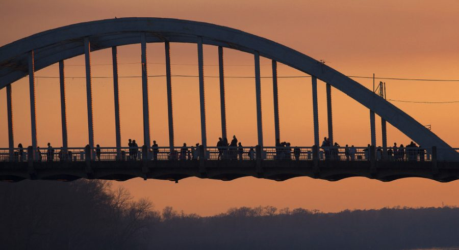 People along the Edmund Pettus Bridge at dusk in Selma, Ala., on Saturday, March 7, 2015. Courtesy of MCT Campus
