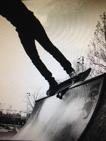 A skater performs a stall on the infamous mini-ramp at Rockville Skatepark. --Mikey Cornwell