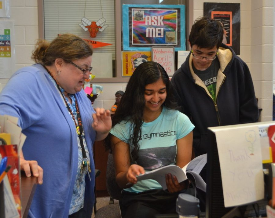 From left: Media Specialist Sherry Weiss talks to student aides senior Lisa D'Souza and junior Avery Eng. IMC hours will be cut due to budget shortages. --Camila Torres