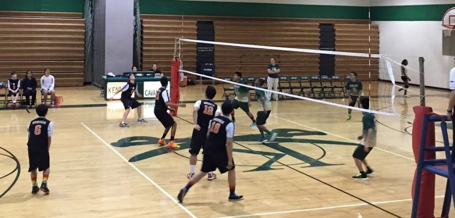 Sophomore+outside+hitter+Doug+Aubertin+begins+his+approach+as+he+is+getting+ready+to+hit+sophomore+setter+Brandon+Kim%E2%80%99s+high+set%2C+while+Kennedy+players+begin+to+jump+to+try+and+block+Aubertin%E2%80%99s+hit.