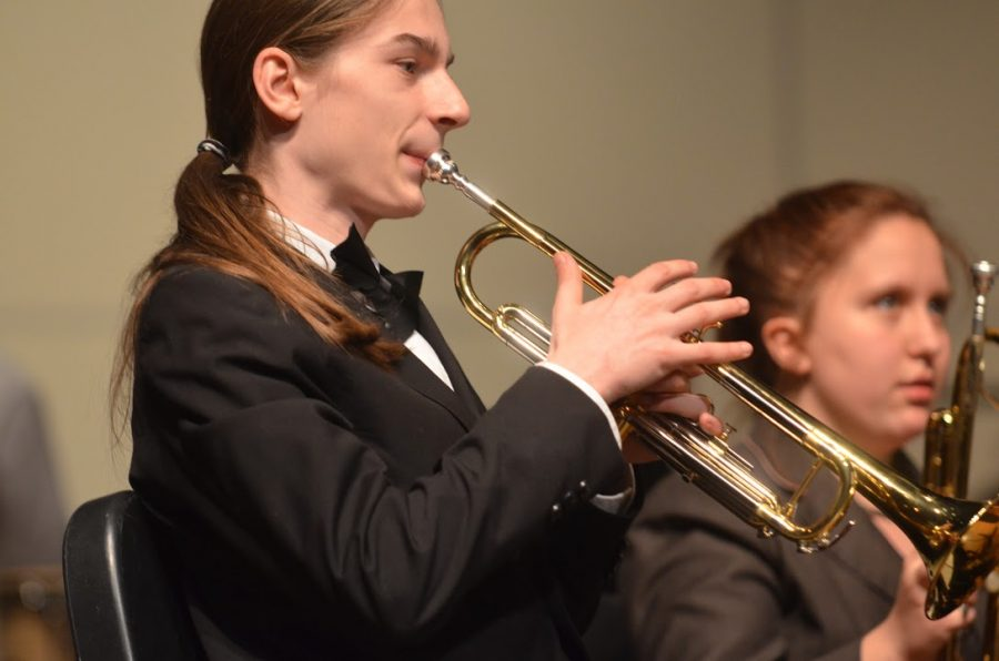 Junior+Cameron+Baker+plays+his+trumpet+at+the+performance%2C+hoping+to+end+the+year+with+a+great+show.