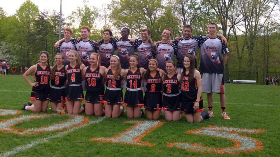The+seniors+on+both+the+boys+varsity+lacrosse+and+girls+varsity+lacrosse+teams+pose+for+Senior+Night.+The+event+to+honor+the+seniors+happened+between+the+two+games.+Courtesy+of+Noelia+Torres