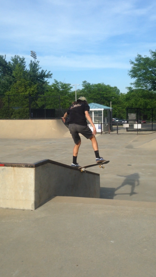 Freshman+Riley+Hughes+does+a+nose+slide+at+the+hubba+at+Olney+Skatepark.