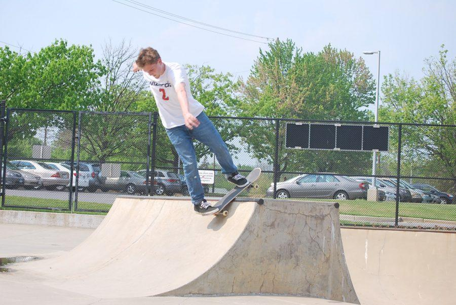 Senior+Mikey+Cornwell+does+a+rock+and+roll+on+the+small+quarter+pipe+at+Olney+Skatepark.