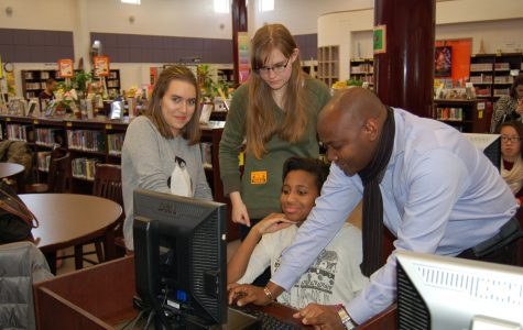 Bob Herbert -- The Rampage From left to right: French exchange students Sarah Desmet and Marie Dhalluin, sophomore Grace D'Almeida and French teacher Sani Adamou work on a computer in the Media Center during one of the scheduled shadow days at RHS for the students during their visit.