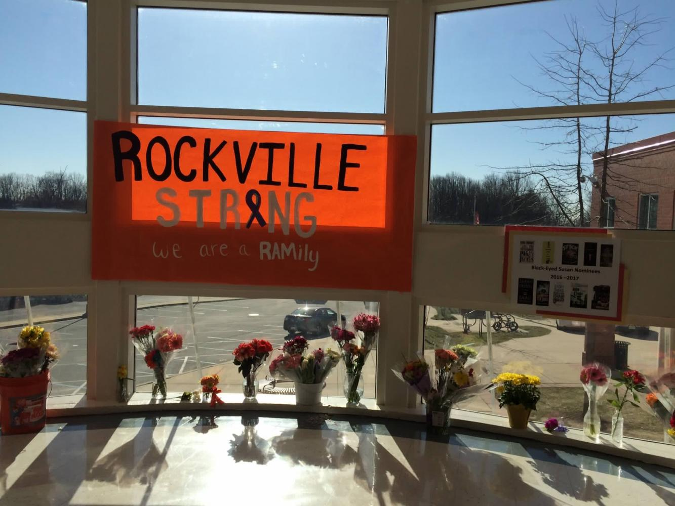 "One of the many ""Rockville Strong"" posters is presented in the Rotunda. Students placed flowers for the victim following the March 16 incident."