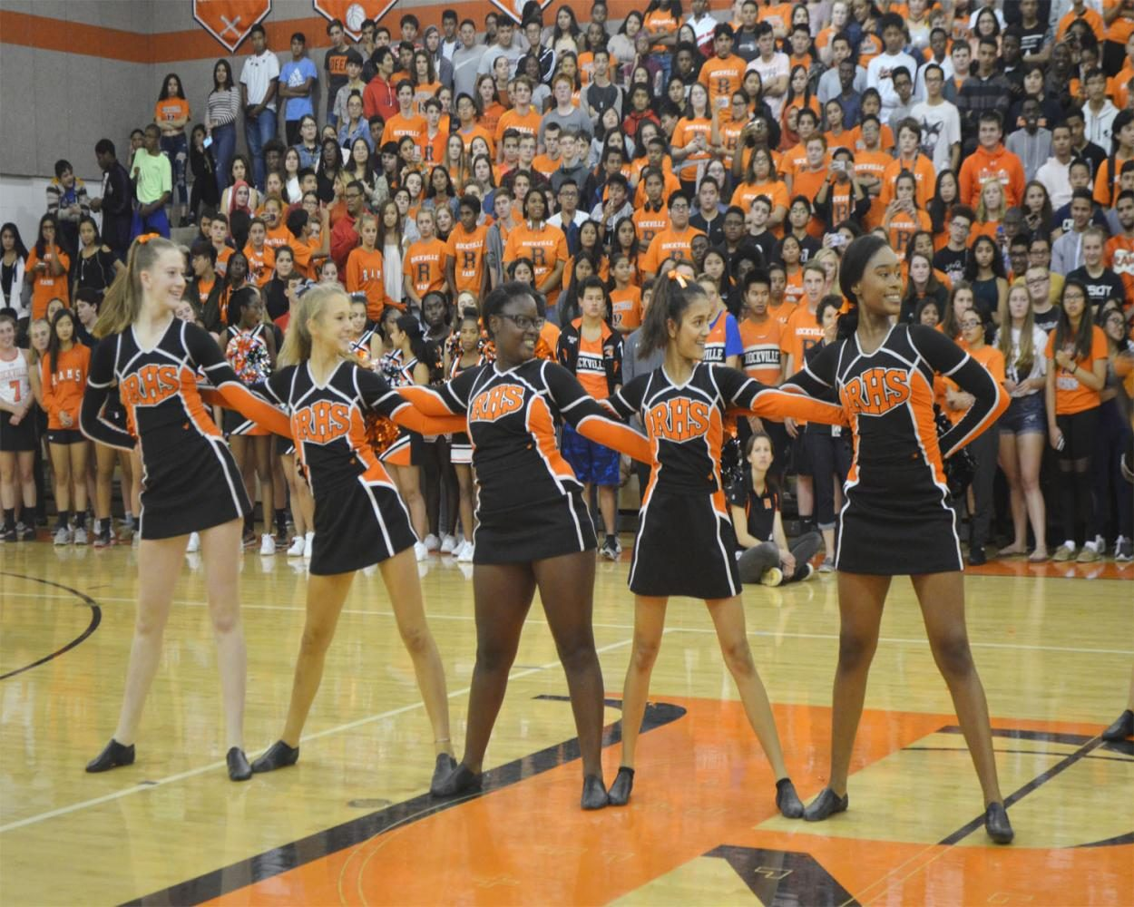 Poms perform at the pep rally.