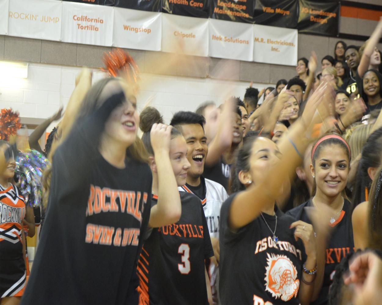 Students cheer enthusiastically as the pep rally activities unfold.