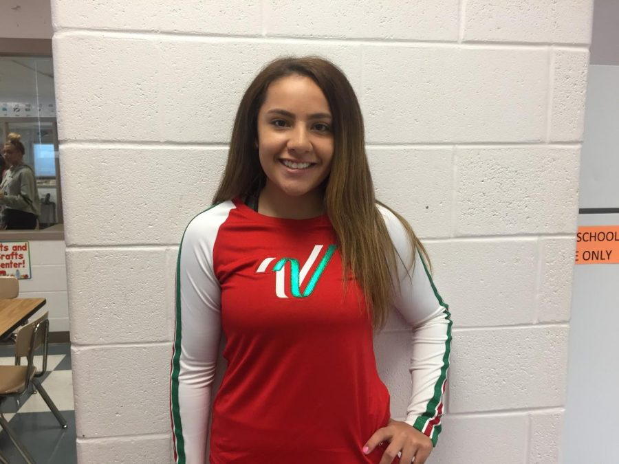 Senior cheer captain Valentina Garzon sports the uniform she plans to wear while participating in a parade at Walt Disney World, after being selected an All-American this summer.