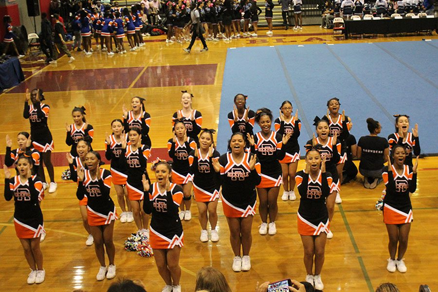 Varsity+cheer+performed+at+the+Division+Three+Cheerleading+Competition+Oct.+26+at+Montgomery+Blair+HS+where+they+placed+fourth.