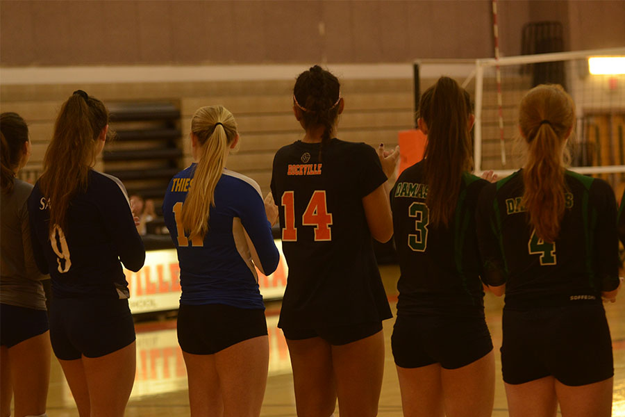 Outside hitter Kaytlin Wack stands with other members of the all star senior volleyball team before the match begins.