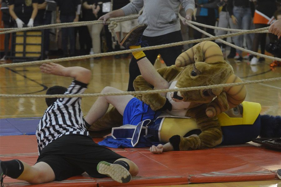 Rammy pins the Trojan for the three count.