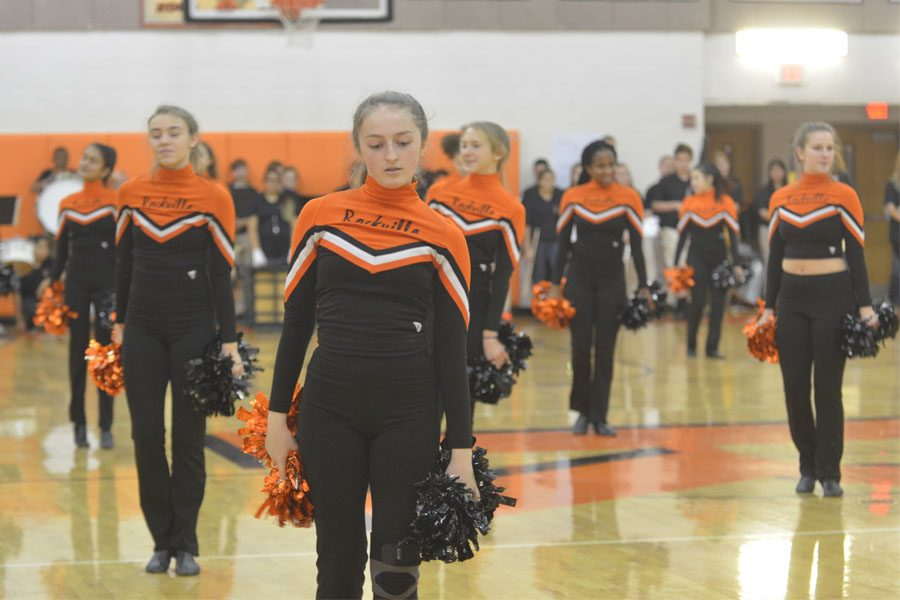 The Poms squad performs their winter routine.
