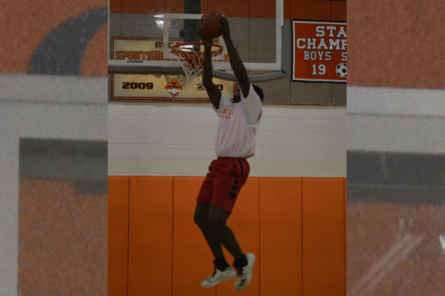 Sorunke trows down a dunk at practice at RHS.