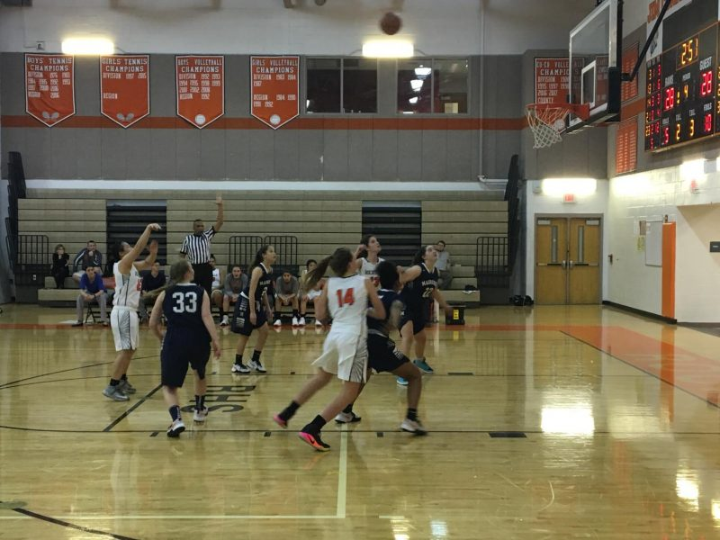 Junior Emily Huynh takes a foul shot to take the lead against the Colonels