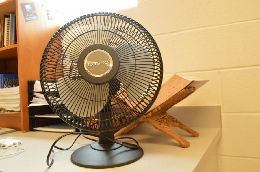 Portable fans become a necessity for classrooms that suffer the most from the broken heat system.