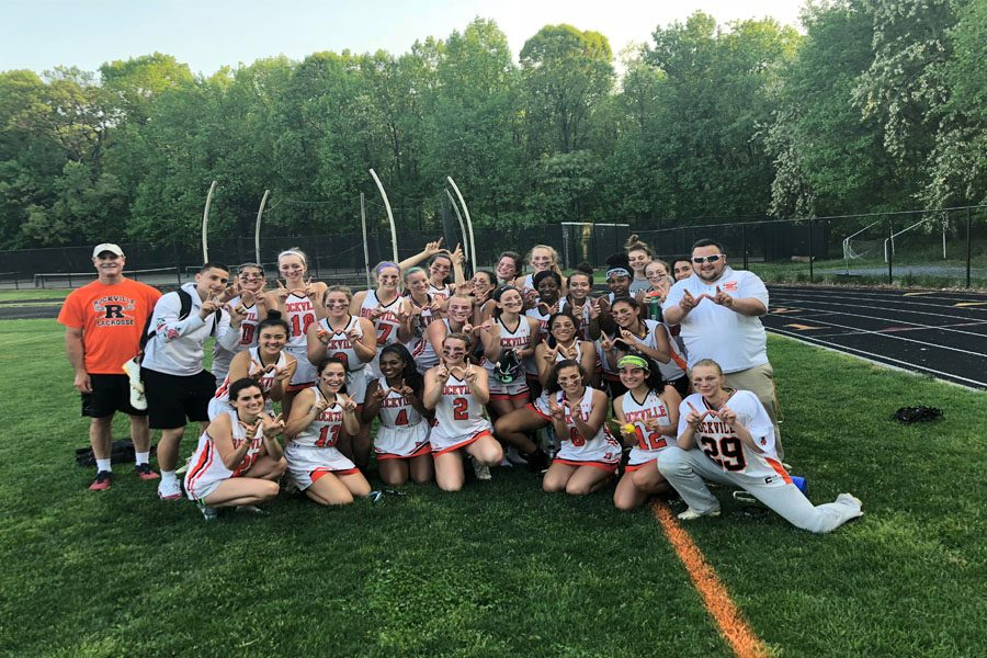 Girls varsity lacrosse poses following their victory over the Magruder Colonels. They fell to the Westminster Owls May 14 ending their playoff run.