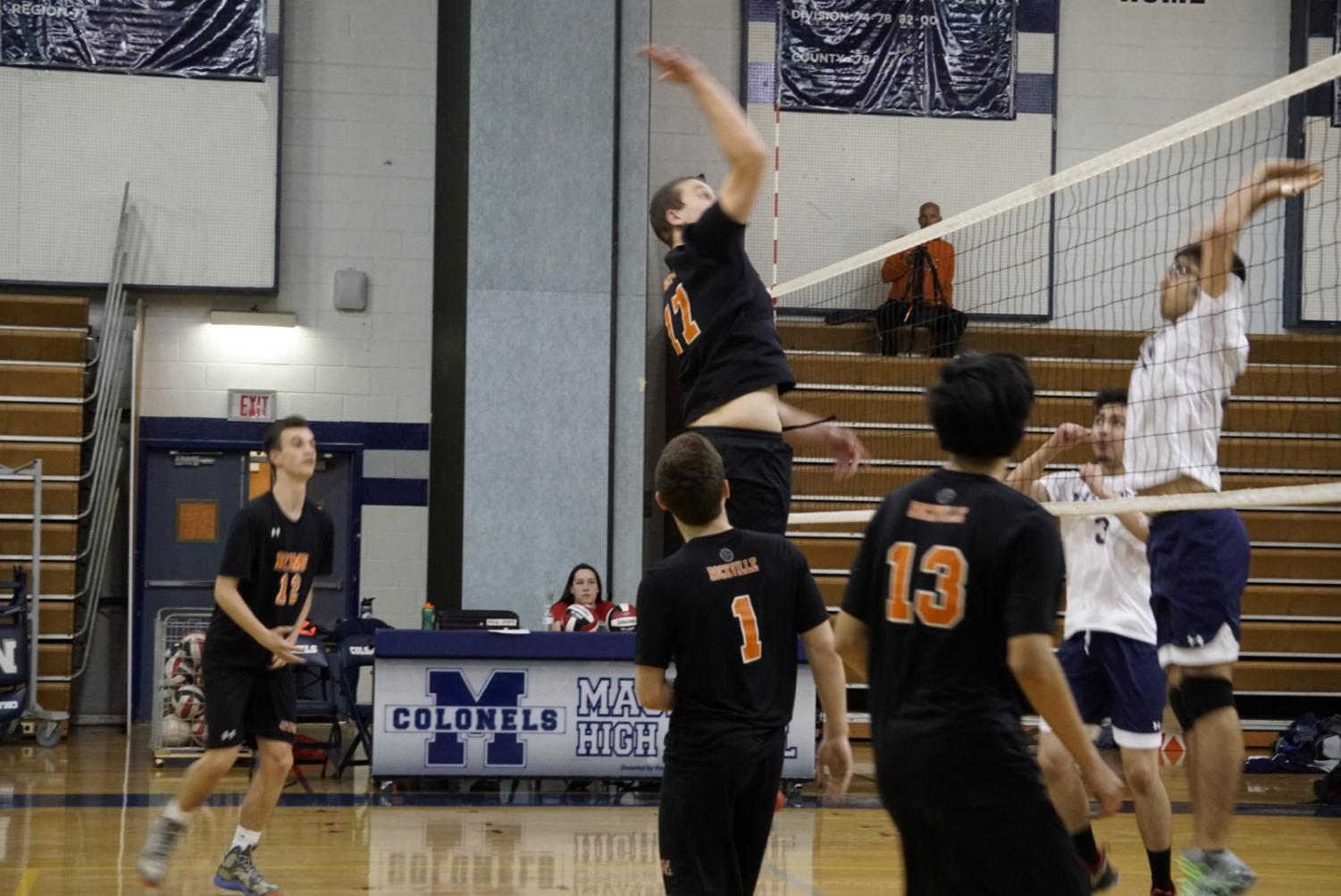 Senior Thomas Rada rises above the net for a kill.
