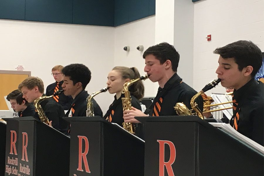 Jazz Band musicians perform at the inaugural Jazz Cafe May 4 in the cafeteria.  They prepared 20 songs for the event.