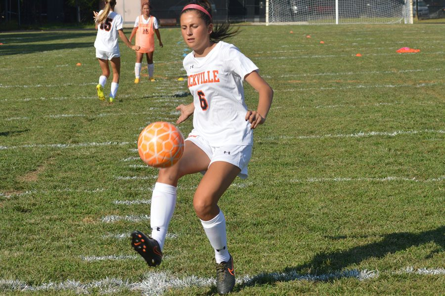 Varsity captian Senior Lauren Giron takes possession of the ball during a home game against Churchill HS in the 2016 season.